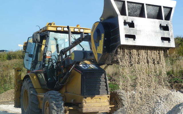 MB-L160 on Caterpillar backoe loader