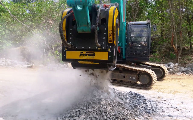 Crusher bucket at work in a road project in India