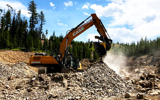A crusher bucket BF120.4 crushing erratics from glaciers to produce aggregate for road construction and structural fill