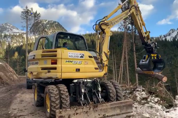 An MB-G900 sorting grapple clearing the roads of fallen tree trunks and debris after a storm.