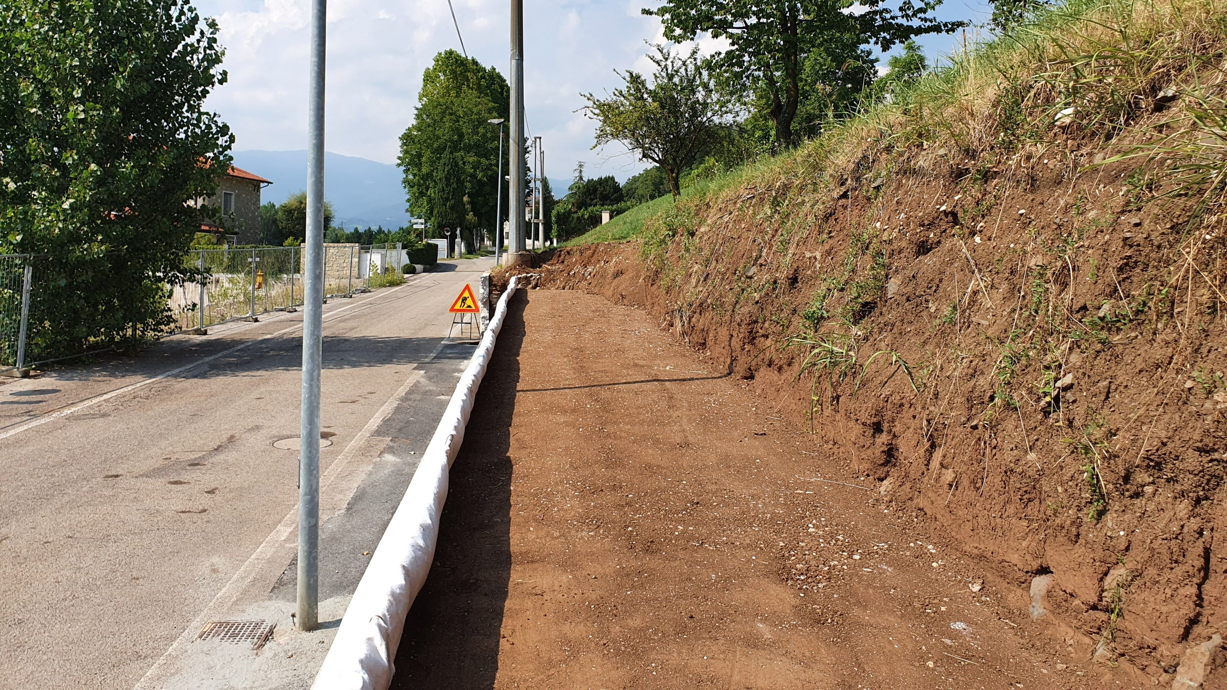 WORK: CONSTRUCTING A ROAD EMBANKMENT